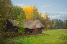 Old Shed Or Barn With Sagging Roof In Autumn Landscape