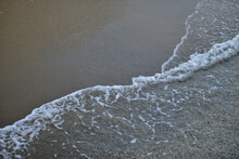 Seawater On The Sandy Beach