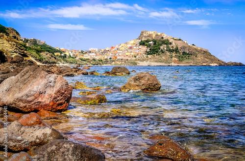 Rocky ocean coastline with colorful town Castelsardo, Italy