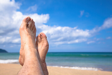 lying on the beach watching my feet and enjoy summer vacation