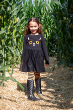A Little Girl Dressed As A Cat