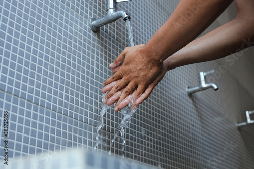 Fototapeta A moslem man take ablution, known as wudu, as one of ritual purification to pray