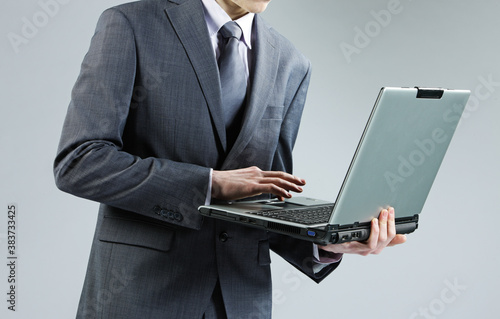 Fototapety, obrazy: Businessman with Laptop