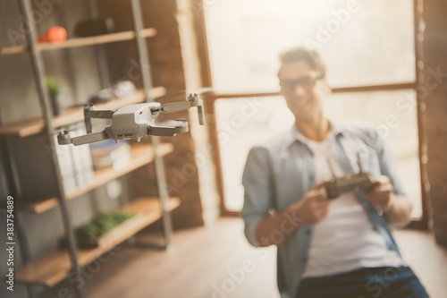 Fototapeta Portrait of his he blurred nice attractive cheerful guy geek skilled expert cont