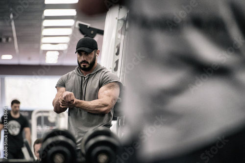 sport injury concept of adult strong athlete bearded male holding his painful wr Canvas Print