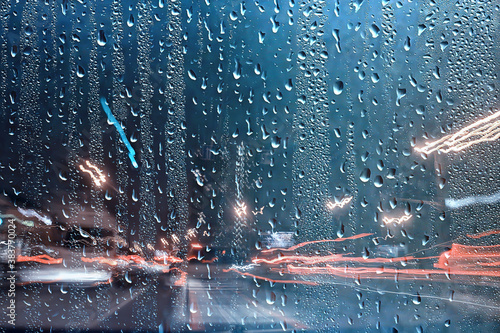 Obraz rain urban traffic cars, night view of the city, traffic flow of city lights abstract autumn background - fototapety do salonu