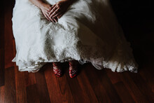 Dress And Shoes. Bride Sitting...