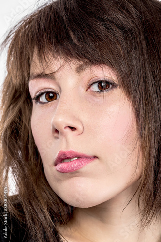 Closeup portrait of an attractive young woman Canvas Print