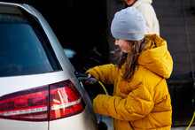 Girl Charging Electric Car