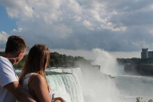 Lovers Are Looking At Waterfall View - Niagara, USA - Canada.