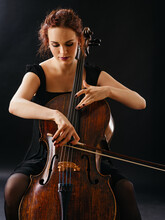Beautiful Female Playing The C...