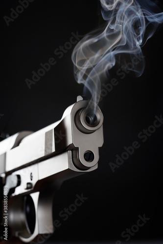 Photo Smoking Handgun against black background