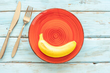 Banana On Yellow Plate And Cut...