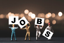 Find And Searching Jobs Due To Economic Depression Crisis Concept ,Miniature Figures Workers Rise Up And Showing Jobs Wording With Orange Background.