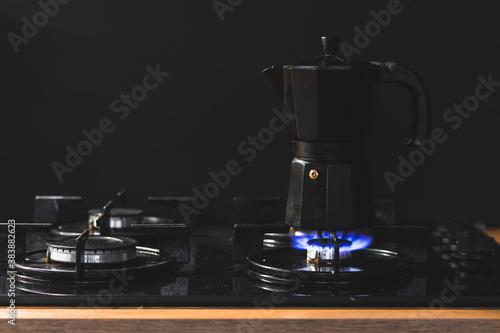 Black geyser retro coffee maker on the gas stove Fototapete