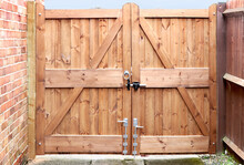 Double Wooden Gates With Metal Handle And Lock Bolt