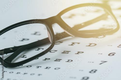 Foto Glasses on the eye sight test chart