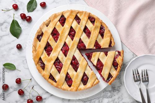 Fototapeta Delicious fresh cherry pie served on white marble table, flat lay