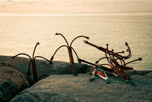 Old Rusty Anchors On The Beach