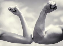 Muscular Arm Vs Weak Hand. Vs,...