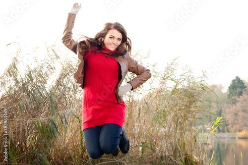 Happy winter girl jumping