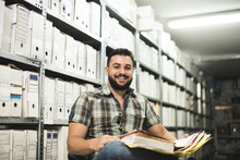 Man Works In Archive And Revie...