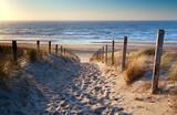 Fototapeta Fototapety z morzem do Twojej sypialni - path to North sea beach in gold sunshine
