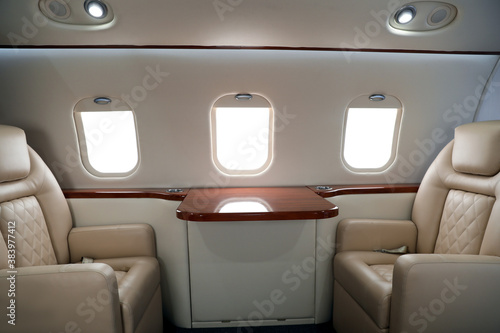 Fotografie, Obraz Airplane cabin with comfortable seats and table