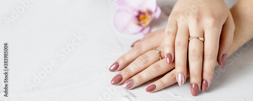 Female hands with fresh manicure Fotobehang