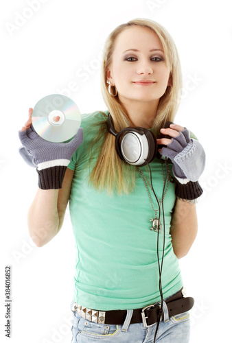 girl with headphones holding cd