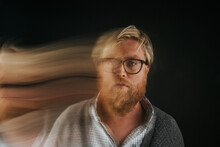 Portrait Of Man With Blurred Motion Standing Indoors