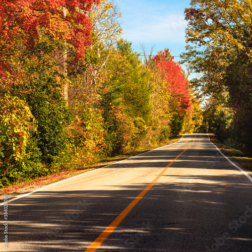 Country road at fall - colorful trees - in Quebec, Canada