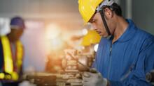 Metal Work Factory Worker Working With Lathe Machine In Lathe Workshop