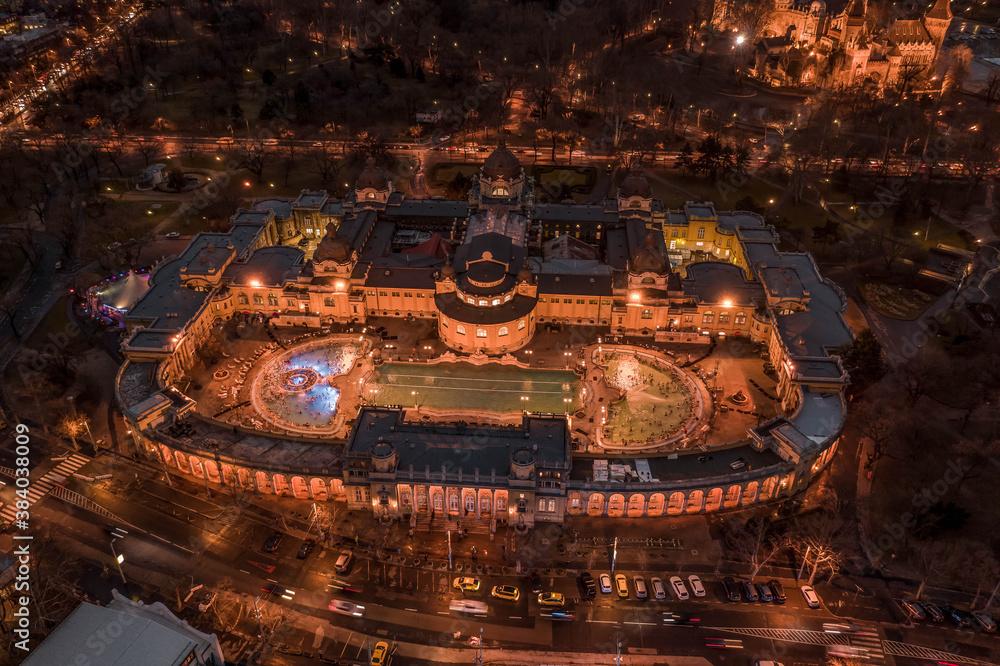 Fototapeta Aerial drone shot of Szechenhyi thermal bath in City Park in Budapest winter dusk with lights - obraz na płótnie