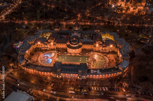 Fototapeta Aerial drone shot of Szechenhyi thermal bath in City Park in Budapest winter dusk with lights obraz na płótnie