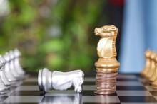 A Golden Horse Chess Piece Sta...