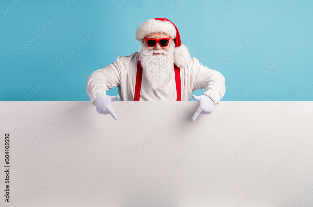 Fototapeta Portrait of his he nice attractive funky confident cool white-haired Santa demonstrating copy space board advice recommend look idea isolated over bright vivid shine vibrant blue color background