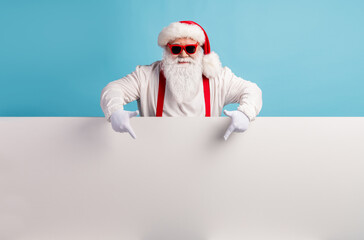 Fototapeta Fitness / Siłownia Portrait of his he nice attractive funky confident cool white-haired Santa demonstrating copy space board advice recommend look idea isolated over bright vivid shine vibrant blue color background
