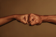 Close Up Of Hands Giving Fist Bump