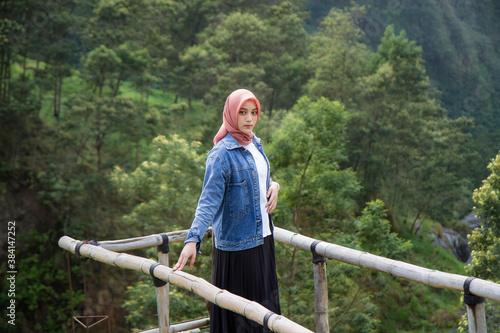 Fototapeta Beautiful asian muslim girl at Kali Talang, Yogyakarta, Indonesia