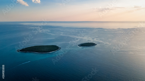 Fotografie, Obraz Drone view of the sister islands Dvije Sestrice Velika and Mala off the coast ne