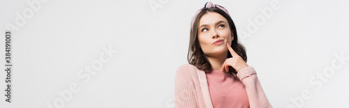 Canvas-taulu horizontal image of pensive woman in headband touching face and looking up isola