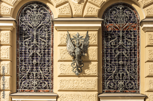 Photo Unique details of the facades of old houses along the embankment of the Griboyedov Canal in St