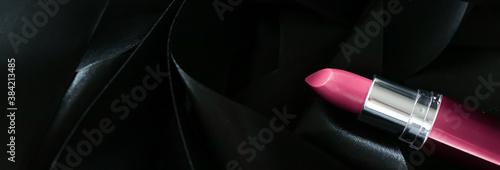 Pink lipstick on black silk background, luxury make-up and beauty cosmetics