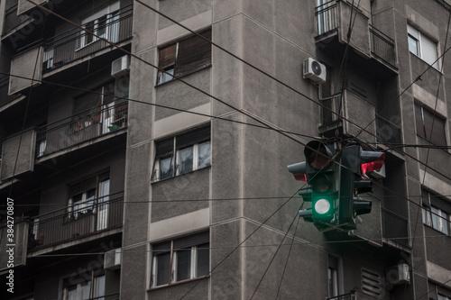 Fototapeta Green light on a Traffic light abiding by European standard regulations taken at