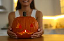 Woman Holding Pumpkin Jack O'l...