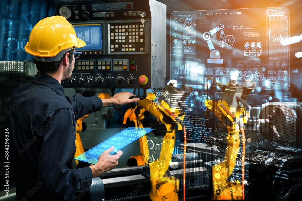 Fototapeta Smart industry robot arms for digital factory production technology showing automation manufacturing process of the Industry 4.0 or 4th industrial revolution and IOT software to control operation .
