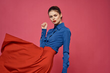 Woman In Blue Shirt And Red Cu...