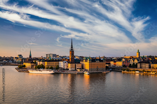 Scenic panoramic view of Gamla Stan, in the Old Town in Stockholm at sunset, cap Fotobehang