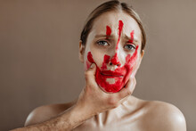 Unhappy Woman With Bloody Hand...